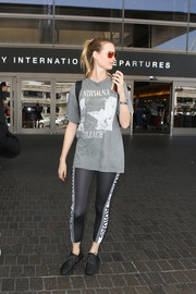Behati Prinsloo sealed off her comfy travel outfit with a pair of Adidas Originals by Alexander Wang leggings.