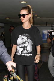 Behati Prinsloo tried to keep a low profile in a pair of dark glasses while making her way through LAX.