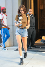 Bella Hadid headed out in New York City wearing a brown polo shirt by Fendi.