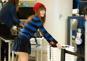 Bella Thorne wore a red knit beanie with her striped sweater for a sweet winter look at the airport.