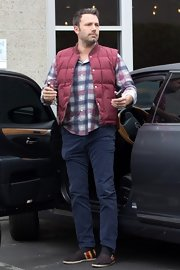 Ben Affleck chose a blue and red plaid shirt to pair with a cranberry vest for a cool and casual daytime look.