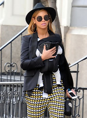 Beyonce topped off her eclectic look with this fun hat while out walking with baby Blue.