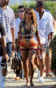 Beyonce paired her printed ensemble with heavy gold chain necklaces.