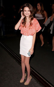 Ciara Bravo balanced a voluminous to with a sleek white pencil skirt.