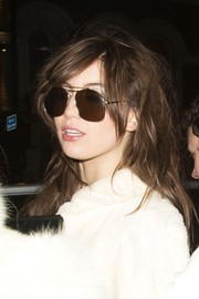Daisy Lowe hid her eyes behind a pair of brown aviators while celebrating her birthday in London.