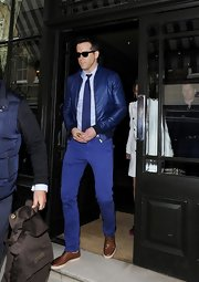 Ryan Reynolds rocked an electric blue bomber and matching pants.