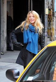 Blake Lively bundled up in a bright blue scarf on the set of 'Gossip Girl.'