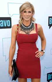 Alexis Bellino paired her curve hugging bandage dress with a heavy metal statement necklace. Chains accented her rockin' look.