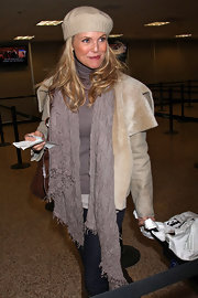 Chrsitie's knit scarf gives her airport ensemble a warm winter look.