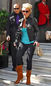 Britney gave her look a country flair with tan mid-calf boots.