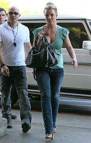Britney was spotted doing dome light shopping at Walmart carrying a quilted leather tote.