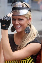 Brooklyn tossed on some fingerless motorcycle gloves for shooting 'Ugly Betty.'