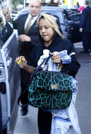 Karreuche carried this emearld leopard print bag to Sydney.