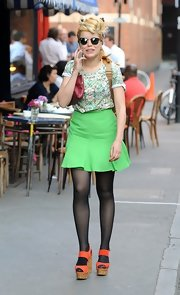 Paloma Faith chose a printed tee to pair with a vibrant green skirt while out in London.