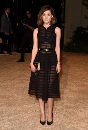 A black and gold chain-strap bag polished off Rose Byrne's look.
