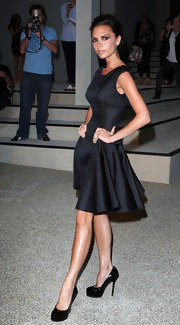 "Mrs. Beckham loves to pair her classic silhouettes with tall ""Trib Two"" pumps."