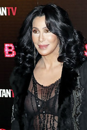 Cher attended the 'Burlesque' premiere flaunting her radiant center part curls.