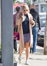 Busy Philipps headed out in LA wearing a cute micro-print mini skirt and a navy sweater.