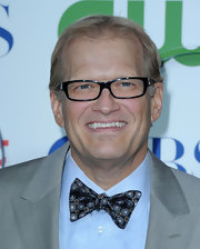 Drew Carey paired his grey suit with a printed bow tie and button down blue shirt.