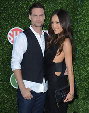 Maggie Q complemented her sultry dress with an embellished zip-around clutch when she attended the CBS Summer Press Tour party.