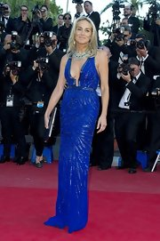 Sharon Stone looked simply sparkly in this electric blue beaded gown with a deep plunging V-neck.
