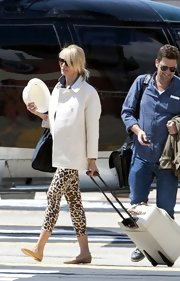 Cameron Diaz chose a pair of leopard-print pants for her travel look while traveling in Monte Carlo.