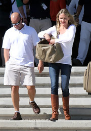 Cameron Diaz looked casual yet chic in flat brown riding boots.