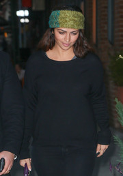 Camila Alves added a splash of color with an olive and teal knit headband.
