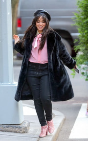 Underneath her coat, Camila Cabello was casual in black lace-up jeans and a pink blouse.