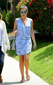 Camilla Belle finished off her airy ensemble with a pair of flat strappy sandals.
