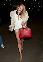Candice Swanepoel carried this classic red leather tote to LAX.