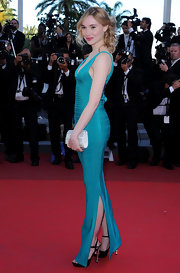 Deborah Francois' white beaded clutch popped against her turquoise bandage gown.