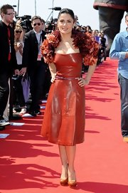 Salma Hayek sizzled in tan leather double platform Fall 2011 pumps.