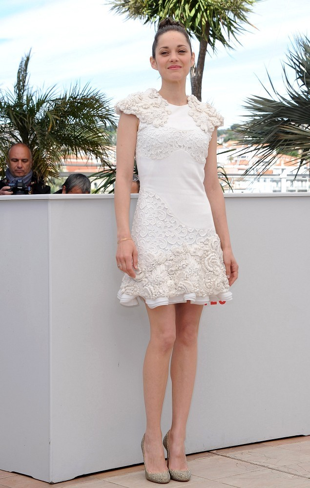 The stars of 'The Immigrant' pose at a photo call during the 66th Annual Cannes Film Festival on May 24, 2013. Pictured: Marion Cotillard.