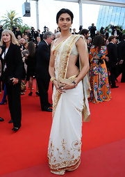 Deepika represented for her country in an authentic Indian design, while walking the red carpet at Cannes.