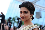 Deepika looked stunning while walking the carpet at the Cannes Film Festival. Her loose bun was the perfect look for her.
