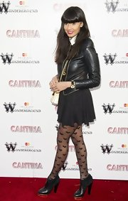 Jameela Jamil teamed her sweet skater skirt with a pair of heart tights at the opening night of Cantina in London.