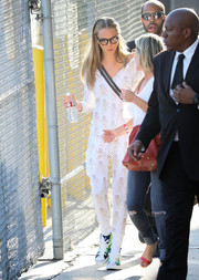 Cara Delevingne arrived for her 'Kimmel' appearance wearing lion-print pajamas.