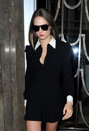Cara Delevingne stepped out of her hotel looking somber in her black Persol sunglasses.