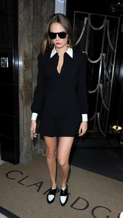 Cara Delevingne looked effortlessly stylish in a black shirtdress with a white collar and cuffs while leaving her hotel.