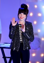 Carly Rae exuded Parisian chic witch a tweed motorcycle jacket paired over a classic striped top.