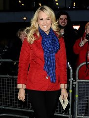 Carrie Underwood bundled up in this red quilted jacket while out at BBC Radio.