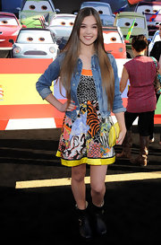 Hailee Steinfeld toughened her youthful print dress with a pair of black combat mid-calf motorcycle boots.