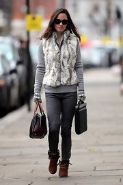 Pippa Middleton trekked through town in ruggedly stylish suede moccasin-style ankle boots.