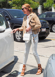 Cat Deeley teamed her jacket with faded blue skinny jeans.