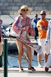 Catherine was spotted in the French Riviera wearing a vibrant multi-colored frock with a hip high slit. She shaded herself from the sun with a wide-brimmed hat and opted for casual sandals.