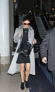 Suede ankle boots are the finishing touch on this high end airport ensemble.