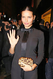 This 'Leopard print box clutch' is a glamourous and sleek alternative to the often overstated bag. In this case Lima accents her solid black ensemble with a splash of animal print.