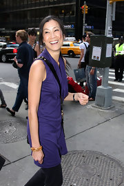 Lisa Ling slipped on a gold bangle that contrasted very well with her purple outfit at the Clinton Global initiative.