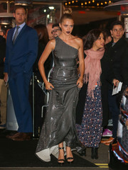 Teresa Palmer dazzled in a silver sequin one-shoulder gown by Prada as she headed to the 'Point Break' premiere.